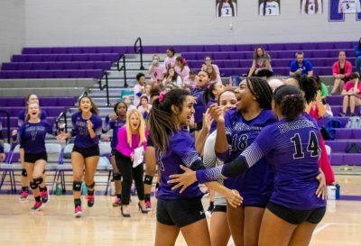 Klein Cain JV volleyball team celebrating a win. Photo by: Tyler Grosvenor.