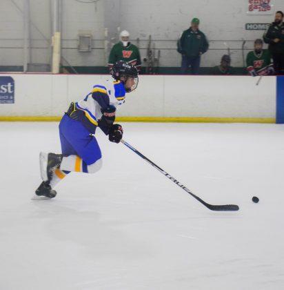 Mitchell Traweek skating towards their goal to score a point. Photo by Nathan DeSimone