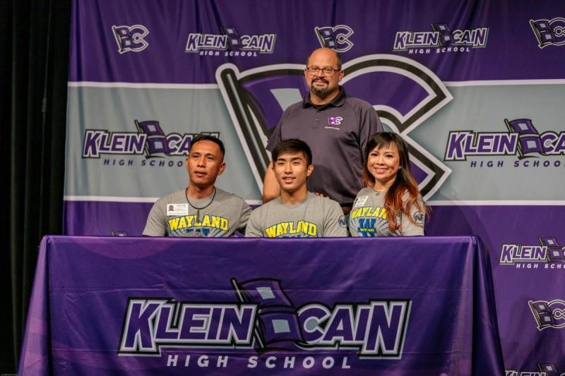 Stephen Nguyen signing to Wayland Baptist University for wrestling.  Photo by: Jacob Elbert